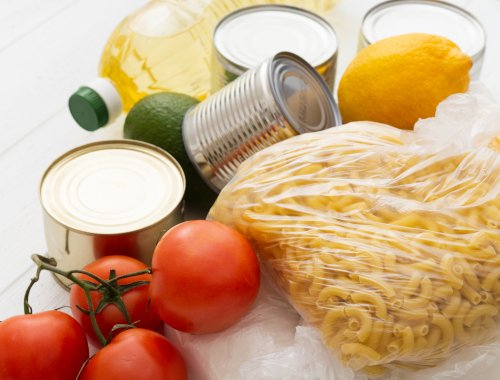 canned food, dried pasta and tomatoes